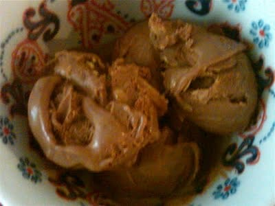 A bowl of chocolate peanut butter ice cream.