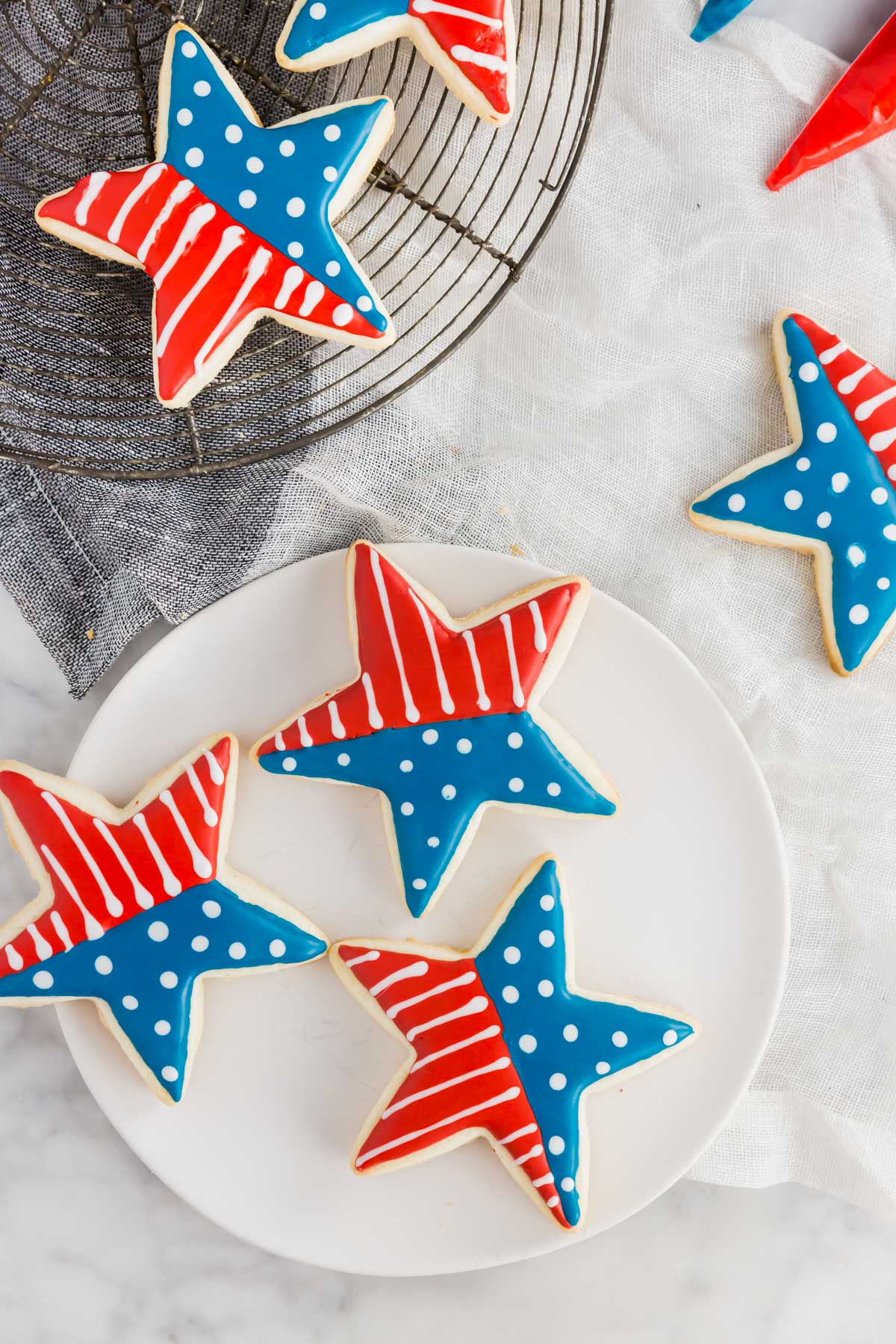 An aerial view of gluten-free 4th of july star sugar cookies with a flag design.