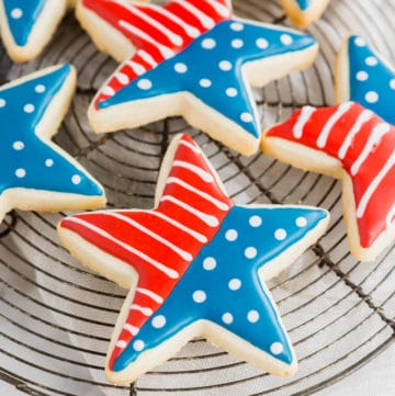 A photo of gluten-free 4th of july star sugar cookies on a cooling rack.