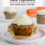 A photo of gluten free carrot cake cupcake with cream cheese frosting with the cupcake liner unwrapped.