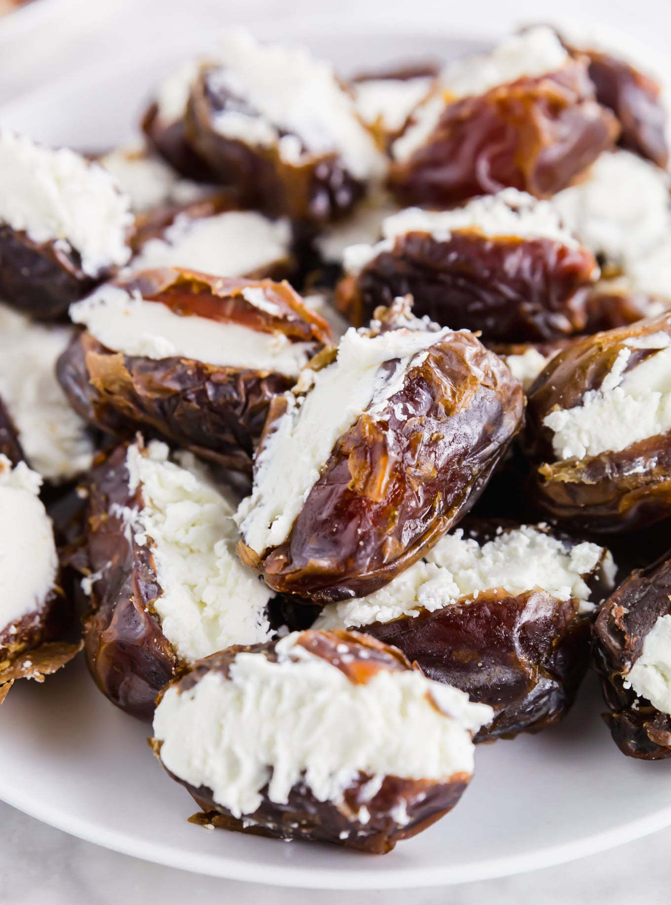 A photo of medjool dates stuffed with goat cheese for easy bacon wrapped dates.