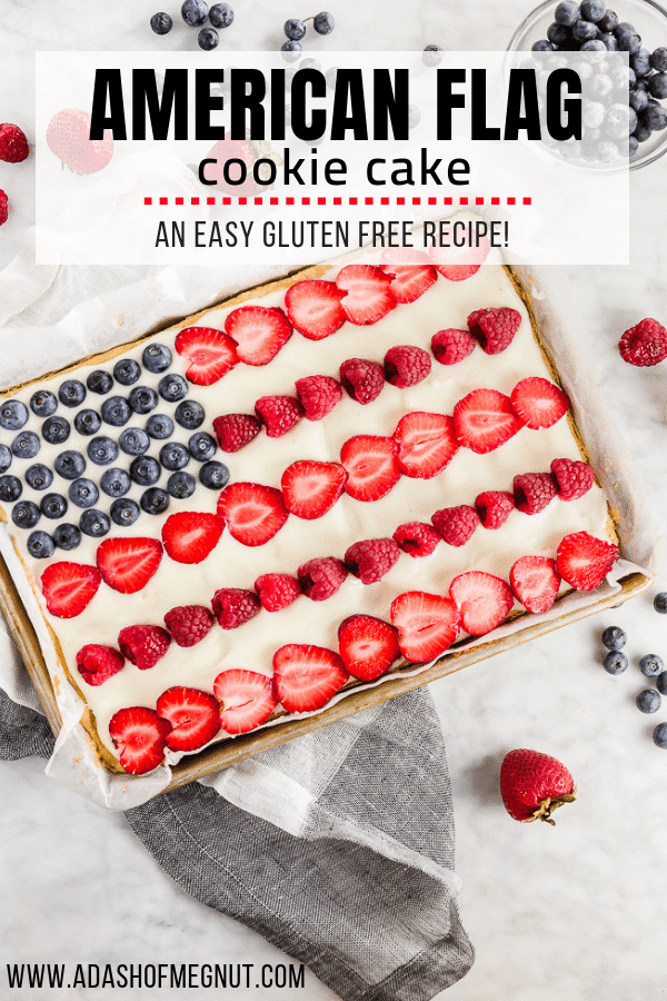 A photo of a gluten free American flag cake decorated with fresh fruit to look like the flag in a quarter sheet pan.