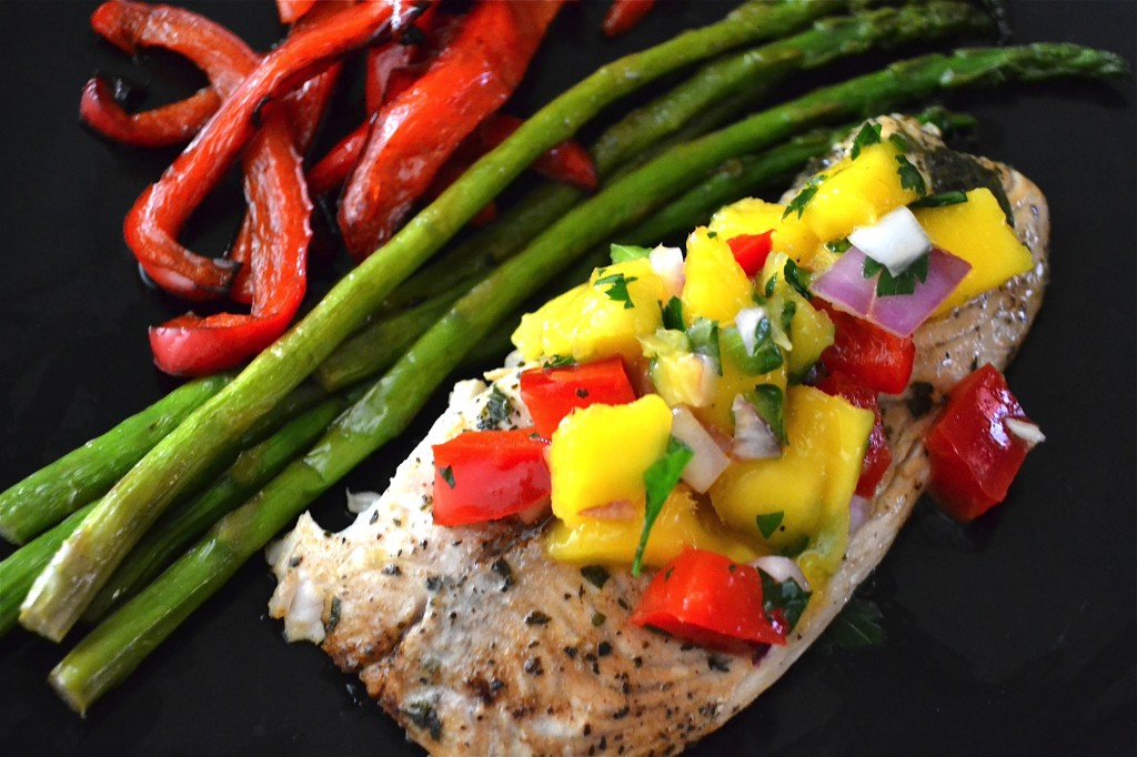 Tilapia topped with mango and bell pepper salsa with a side of asparagus and roasted red peppers.