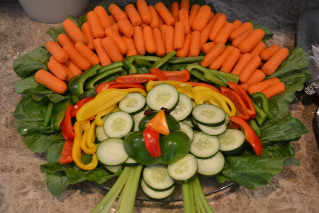A veggie tray in the shape of a turkey.