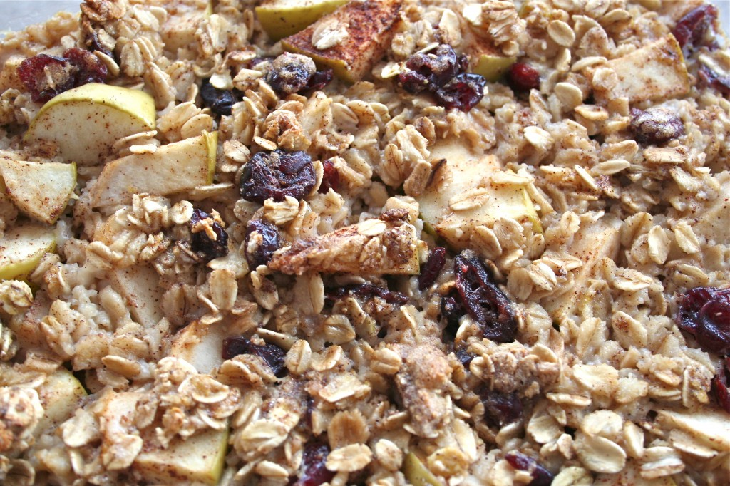 A closeup of apple baked oatmeal topped with dried cranberries.