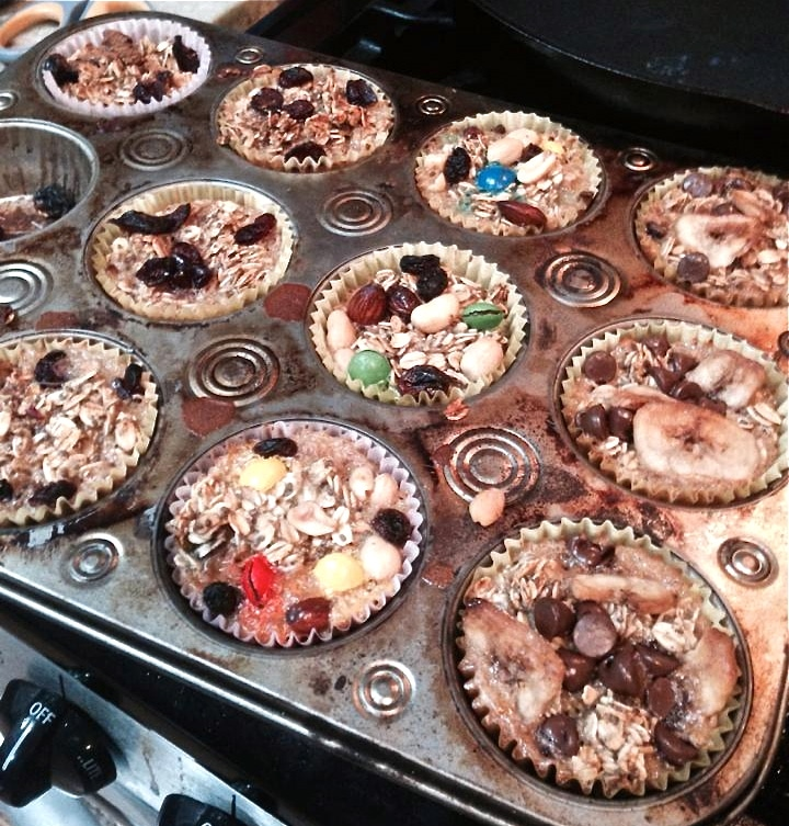 A muffin tin filled with baked oatmeal cups.