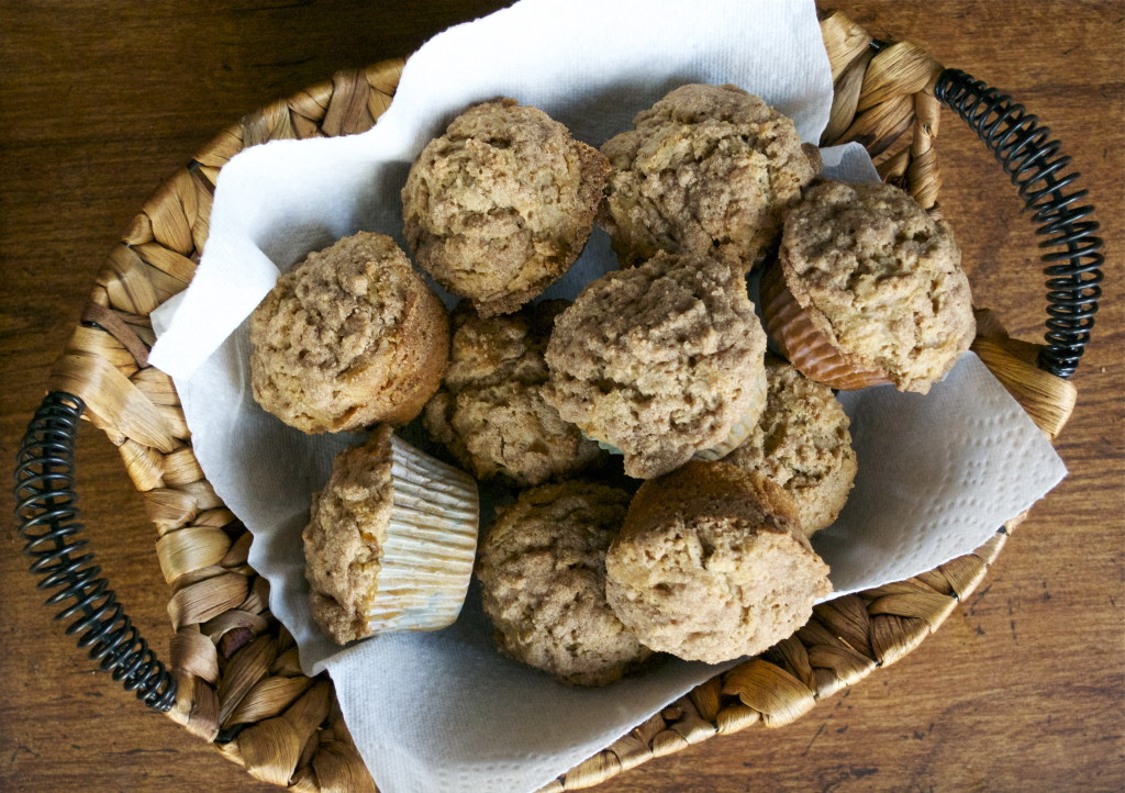 A basket of gluten-free cinnamon streusel muffins.