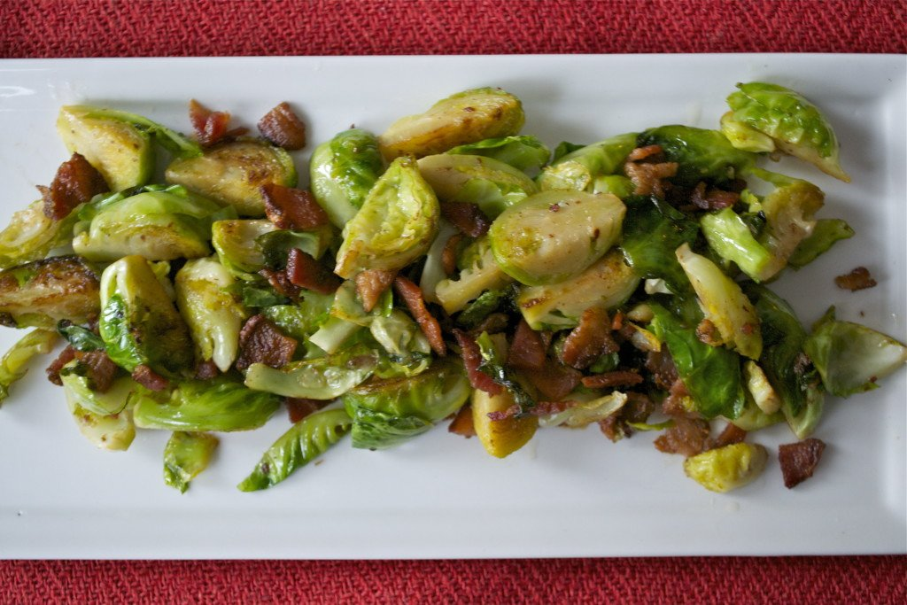 A platter of sautéed brussels sprouts and bacon.