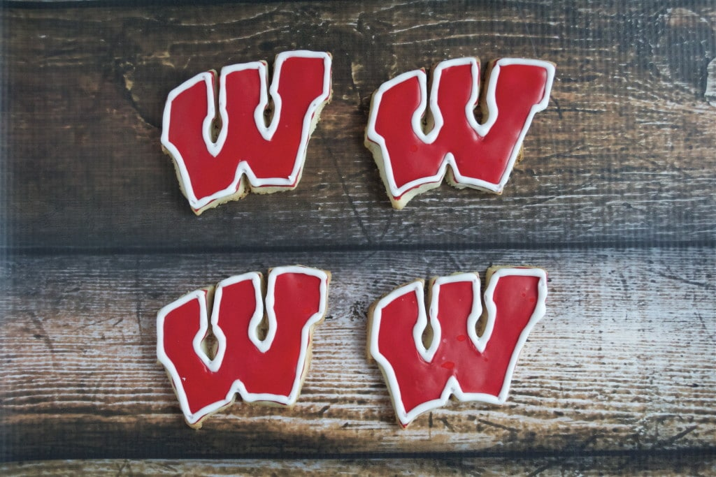 Sugar cookies decorated with royal icing to look like Wisconsin Badgers logo Motion W.