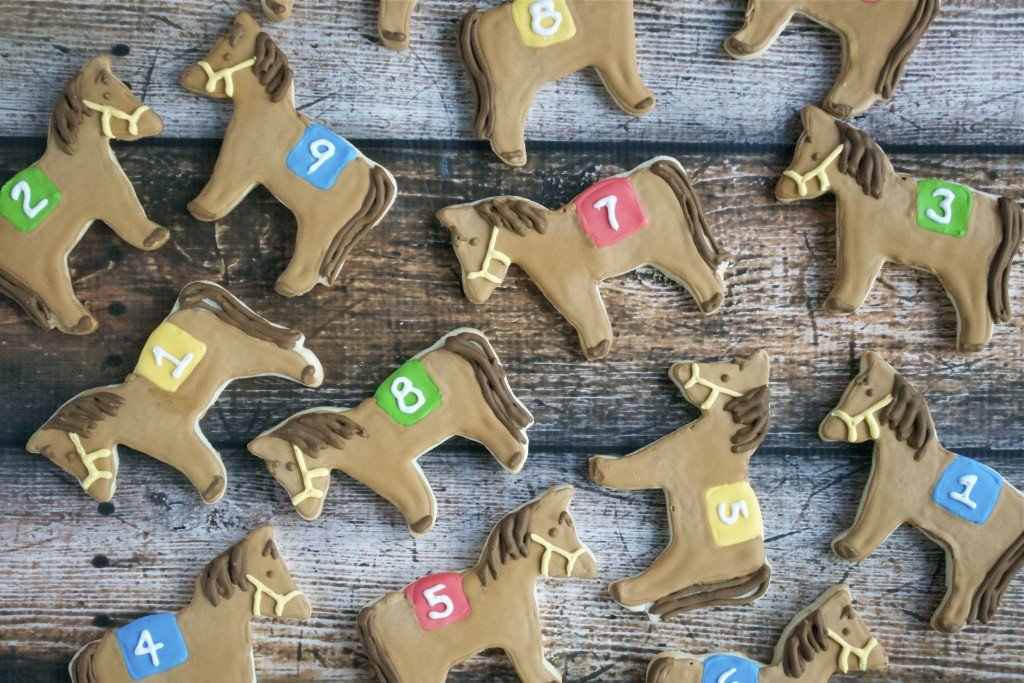Sugar cookies decorated with royal icing to look like Kentucky Derby horses.
