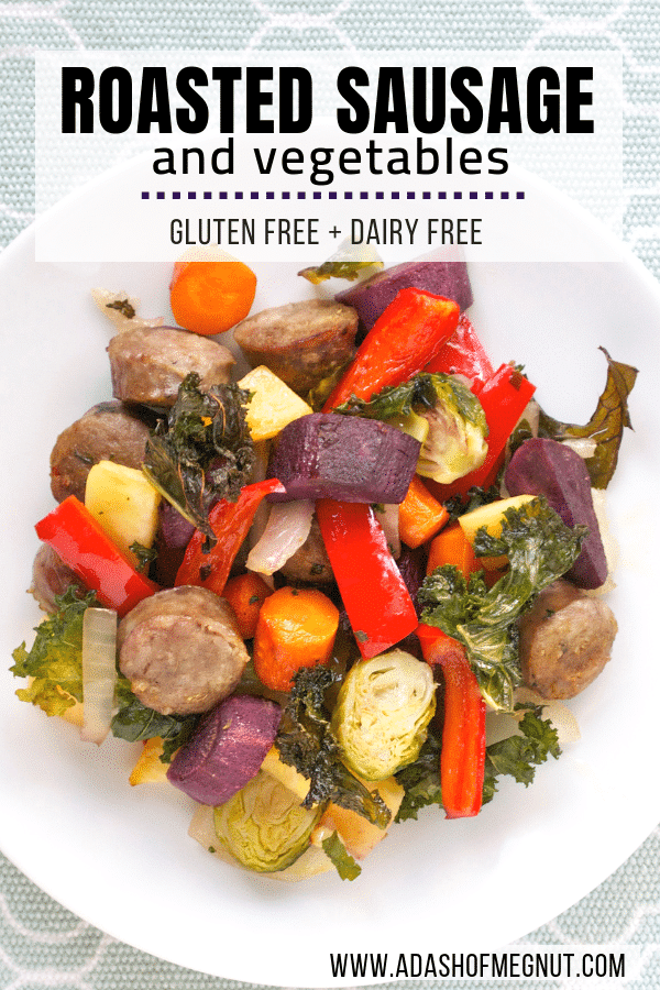 A plate of roasted sausage and colorful vegetables.
