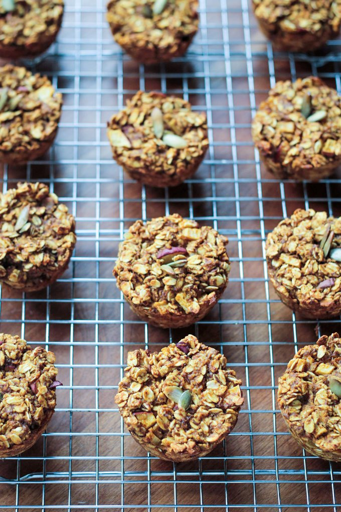 A cooling rack with pumpkin oatmeal bites topped with pumpkin seeds.