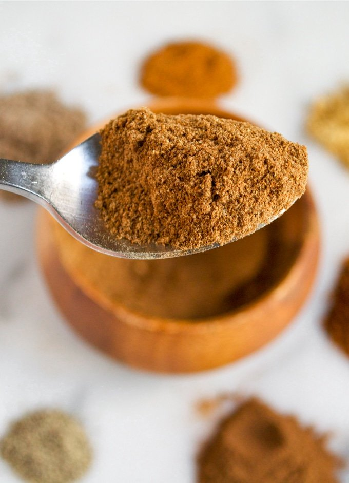 A spoon full of chai spice mix.