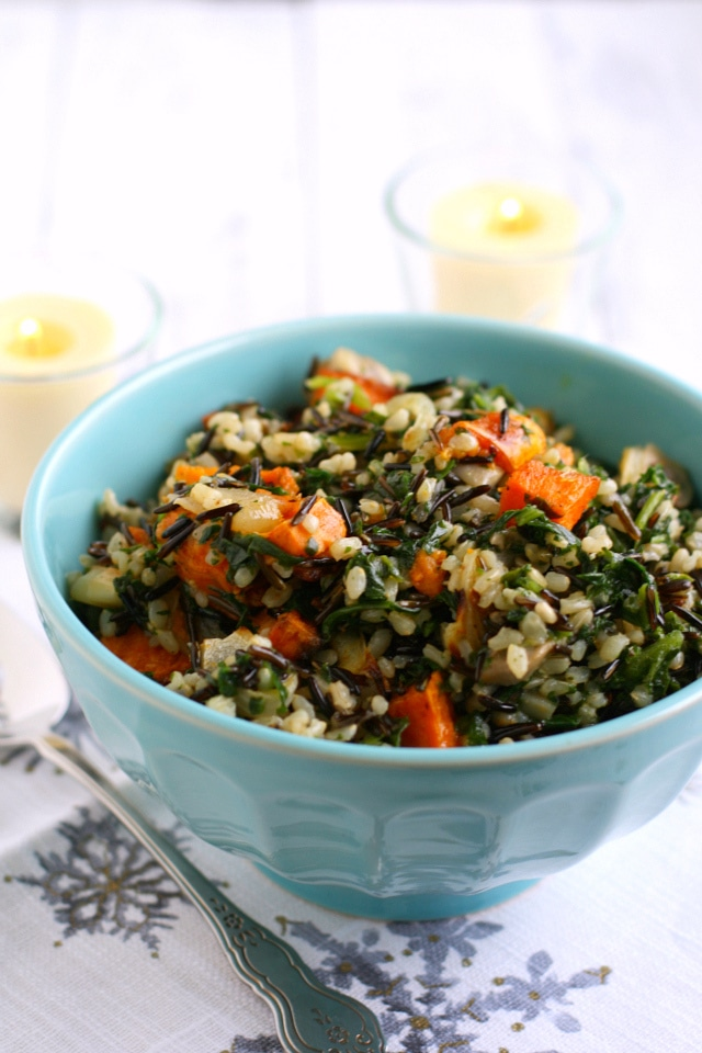 A bowl of sweet potato, rice, and kale.