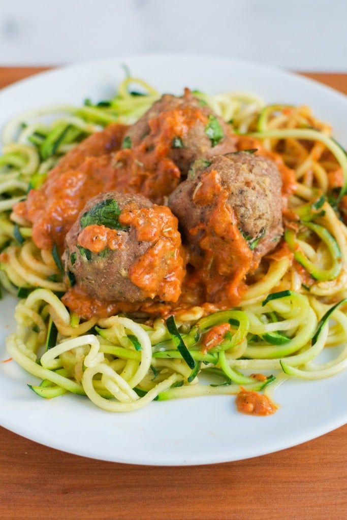 Zoodles with Turkey Meatballs in a Roasted Red Pepper Sauce on a plate.