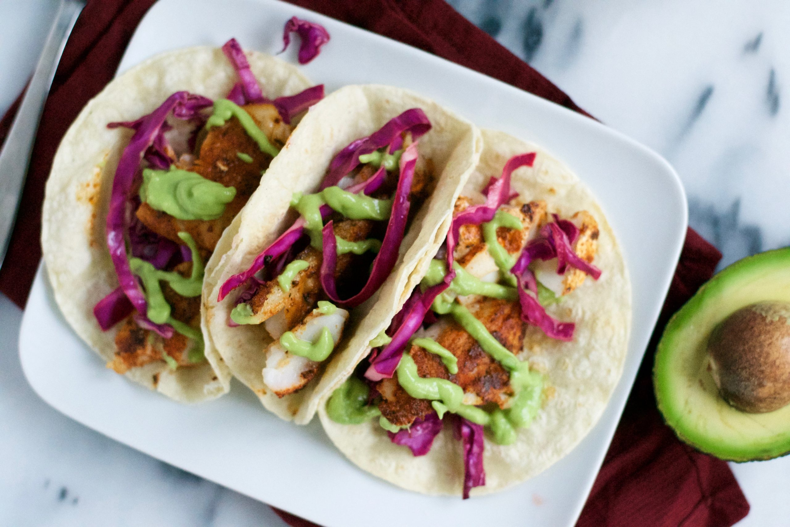 Blackened fish tacos with avocado crema a dash of megnut for Blackened fish tacos