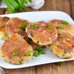 Savory leftover mashed potato cakes are an easy way to use up those leftovers from Thanksgiving. Gluten-free, dairy-free and egg-free, these little cakes are filled with bacon and green onions for an extra punch of flavor. You'll love how easy these are to make too! Recipe from A Dash of Megnut at www.adashofmegnut.com