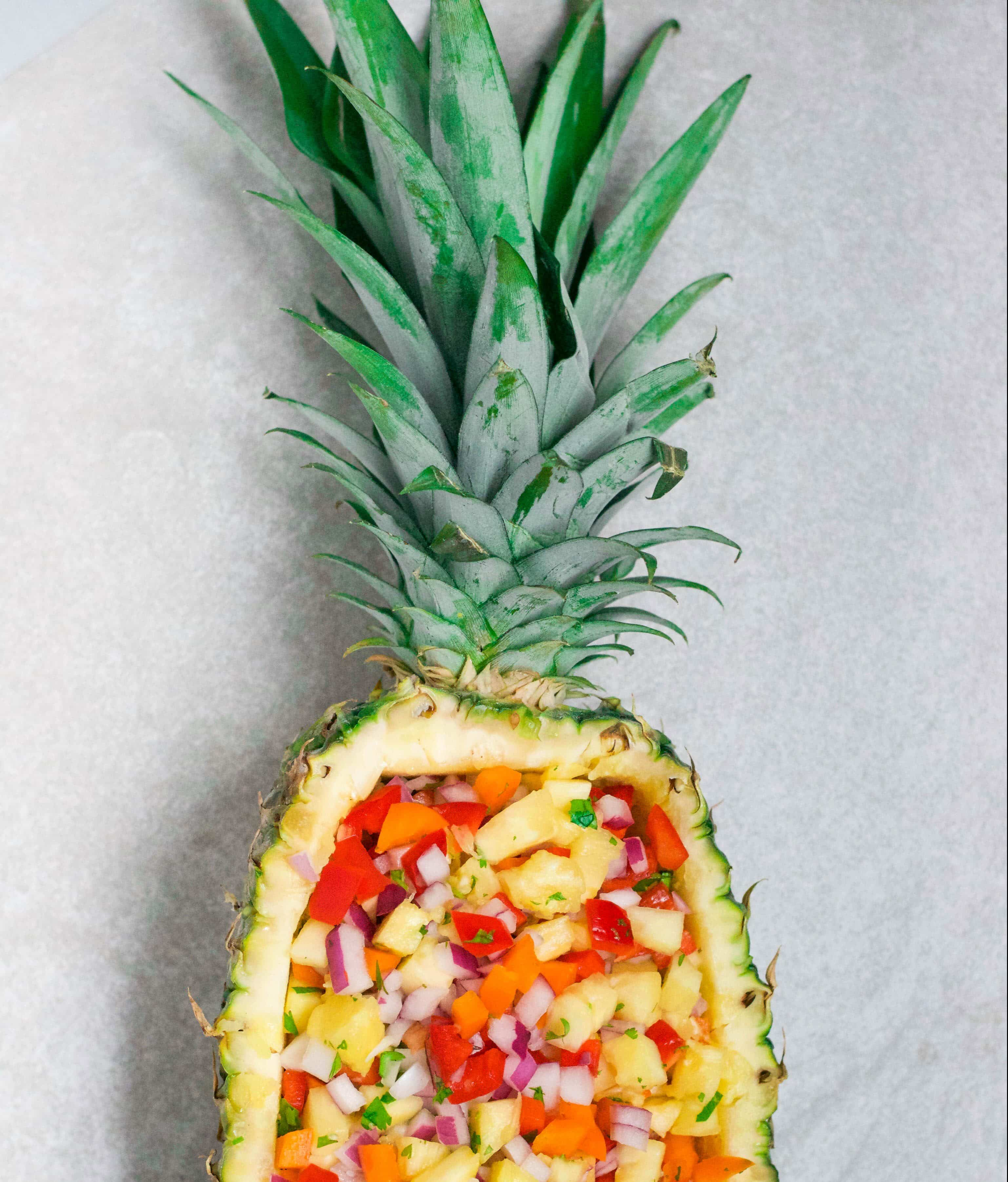 This pineapple salsa served in a pineapple boat is a serious show stopper! Not to mention delicious, too! It's naturally gluten-free, dairy-free, and vegan - making it the perfect party appetizer for all of your friends! Get the recipe at A Dash of Megnut www.adashofmegnut.com.