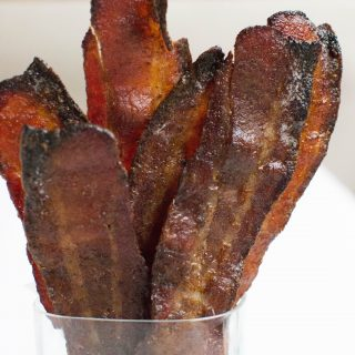 Gingerbread candied bacon, molasses, ginger, cloves, cinnamon, brown sugar, all baked in the oven to perfection. Gluten-free too!