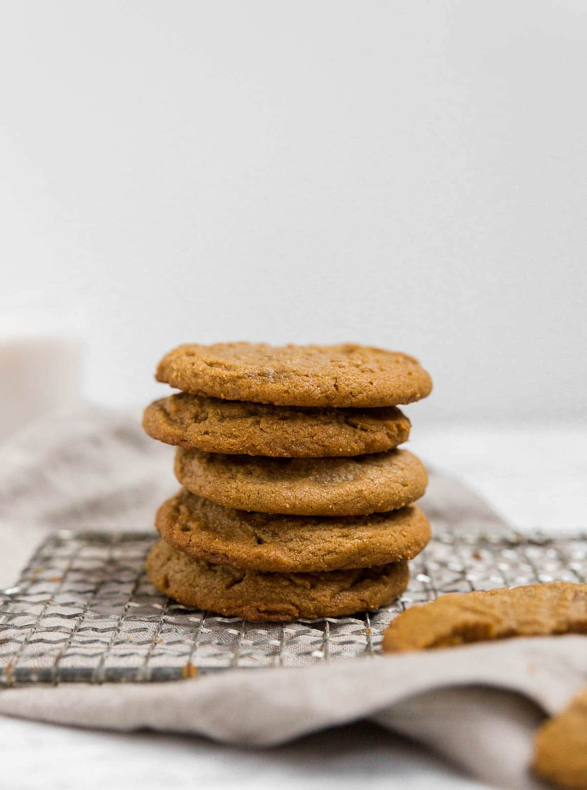 A straight on shot of a stack of flourless peanut butter cookies.