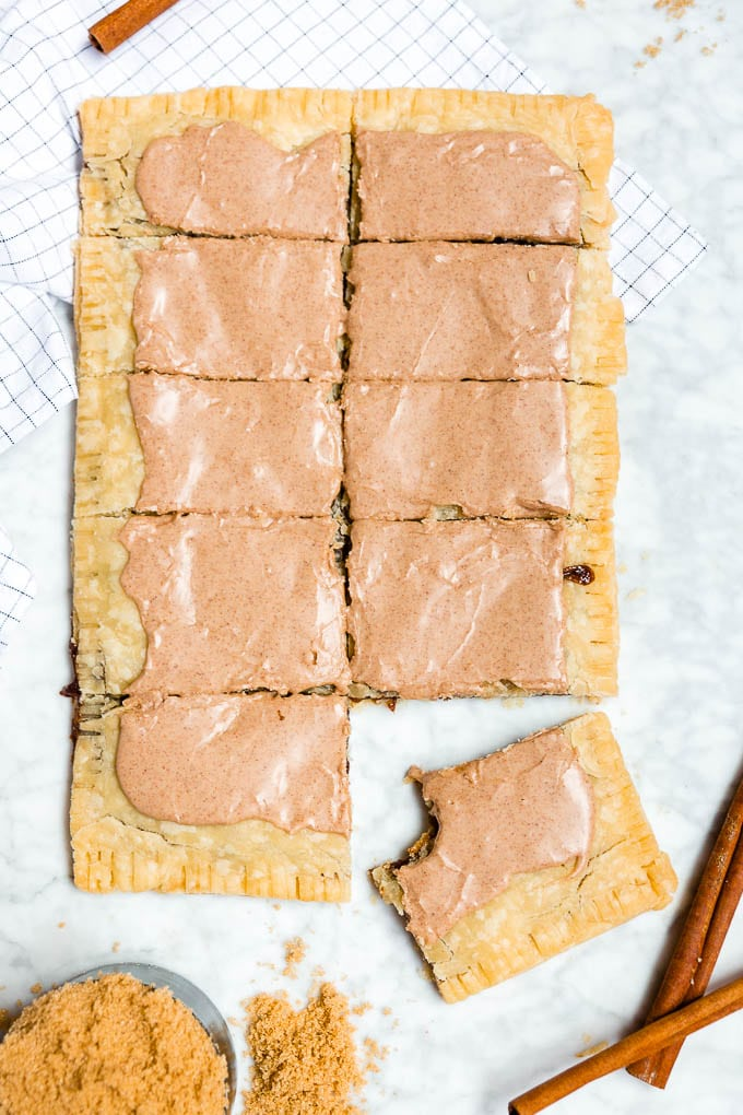 A giant brown sugar cinnamon pop tart sliced into ten pieces.
