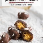 Several chocolate covered peanut butter stuffed dates topped with shredded coconut on white parchment paper.