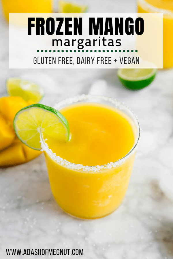 A photo of a frozen mango margarita with a salt rim and lime wedge.