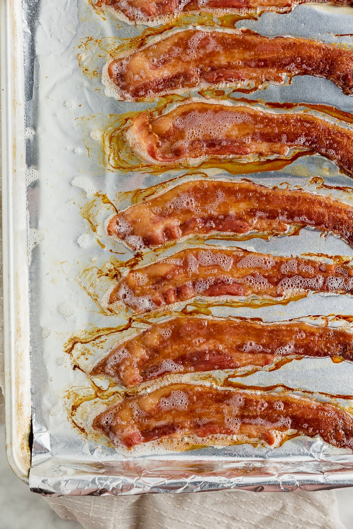 A baking sheet with cooked bacon straight fro the oven.