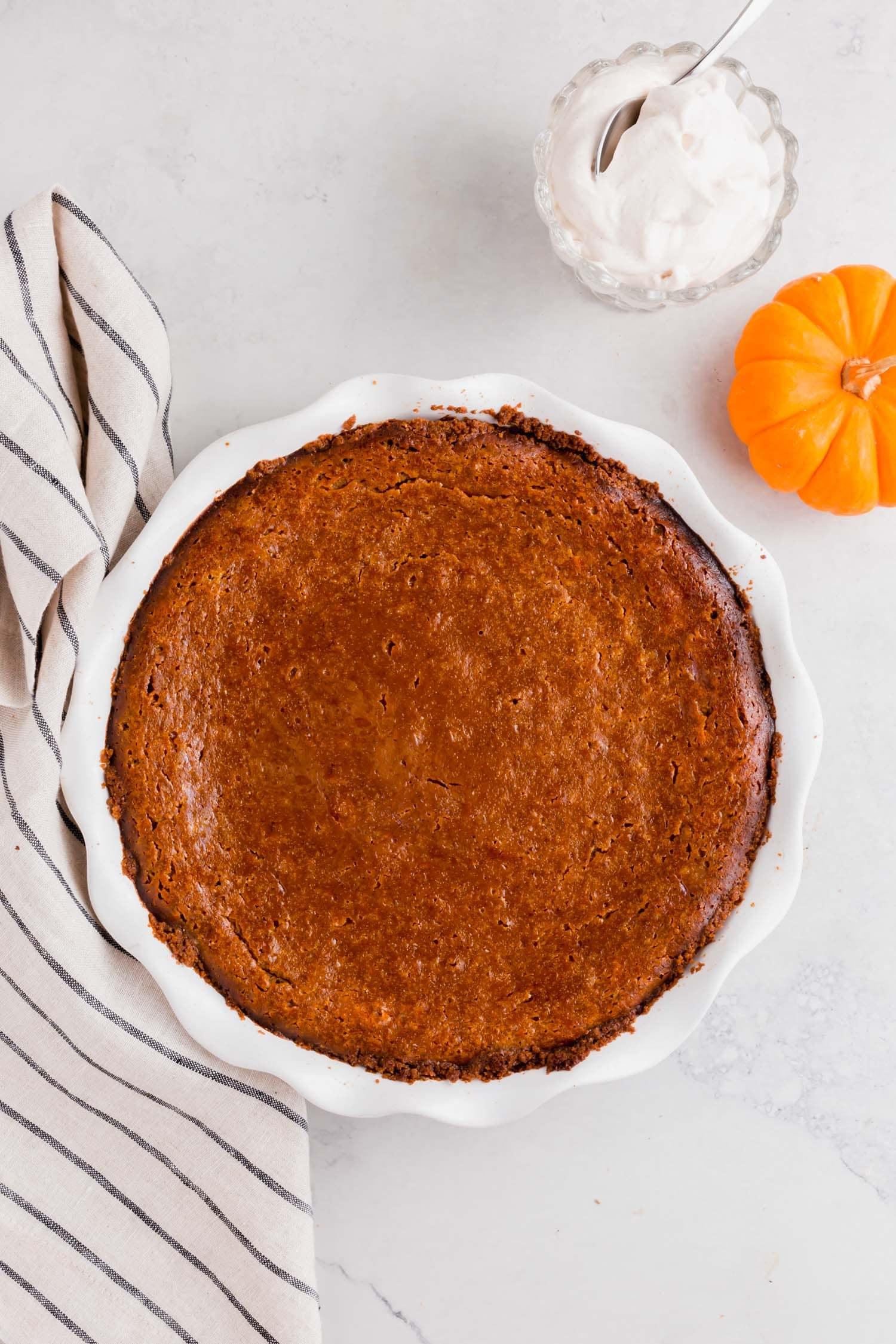 A gluten-free pumpkin pie with graham cracker crust after baking.