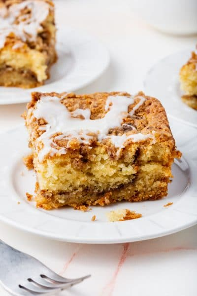 A slice of gluten-free cinnamon coffee cake on a small plate.