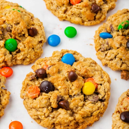 A tray of monster cookies with M&M candies sprinkled about.