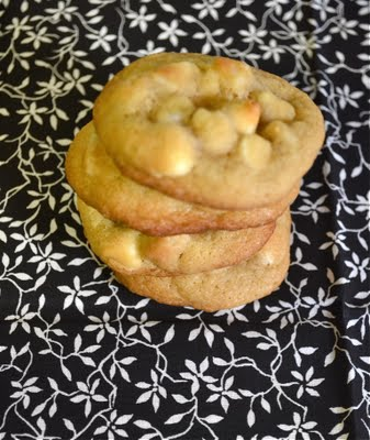 A stack of white chocolate macadamia nut cookies.