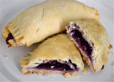 Blueberry hand pies on a white plate.