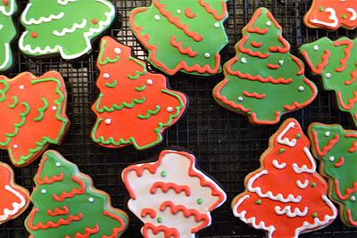 Christmas tree sugar cookies on a cooling rack.