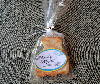 A wedding dress sugar cookie in a treat bag tied with a bow.