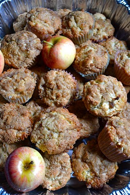 A pile of apple cinnamon muffins with honeycrisp apples.