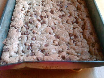 A metal baking dish with chocolate chip cookie bars in it.