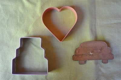 Cookie cutters on a table cloth.
